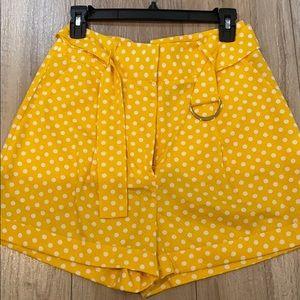 High waisted polka dot shorts.